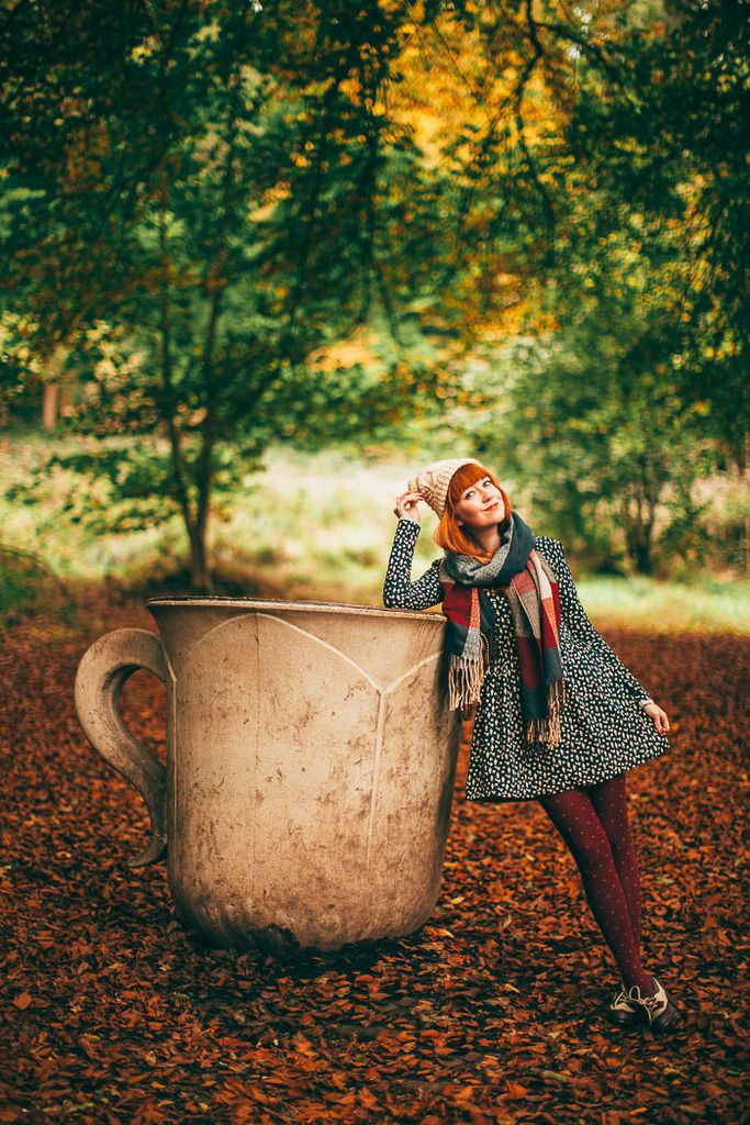A Clothes Horse: Rebecca is amazing. Love the dotty dress and spotty tights, and this teacup shot is dreamy. Would make a fabulous giant poster for my wall...