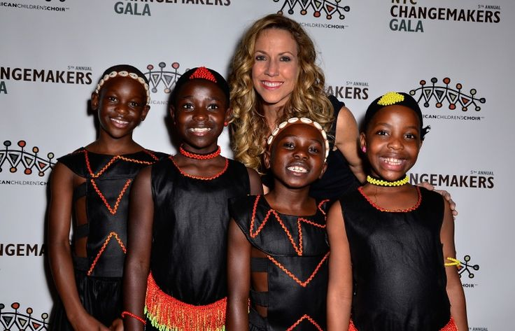 Sheryl Crow and members of the African Children's Choir soak up some fun at the 5th Annual NYC ChangeMakers Gala on Nov. 21 in New York