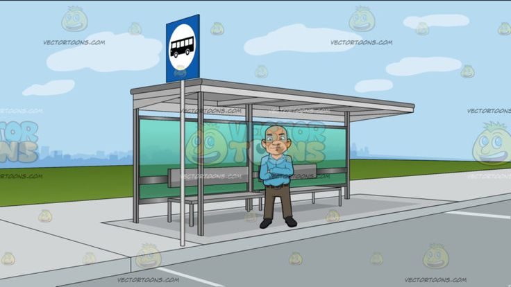 A Bald Guy Standing With His Arms Crossed Over His Chest At A Bus Stop At The Side Of A Street :  A bald man wearing a light blue collared long sleeved shirt brown belt light brown pants and dark gray shoes smirks while crossing his arms on top of his chest. Set in a bus stop with gray bench and waiting shed as well as a blue road sign with a black bus symbol situated alongside the white pavement of a road outside the bustling business area.