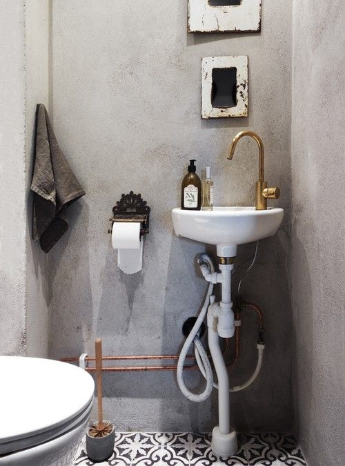 Love the moroccan tiles in combo w the concrete walls