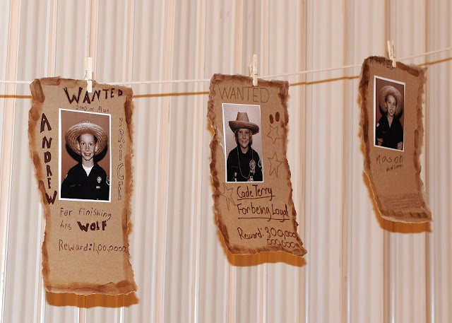 Blue & gold with a western theme.  I love the wanted posters!  They are awesome!