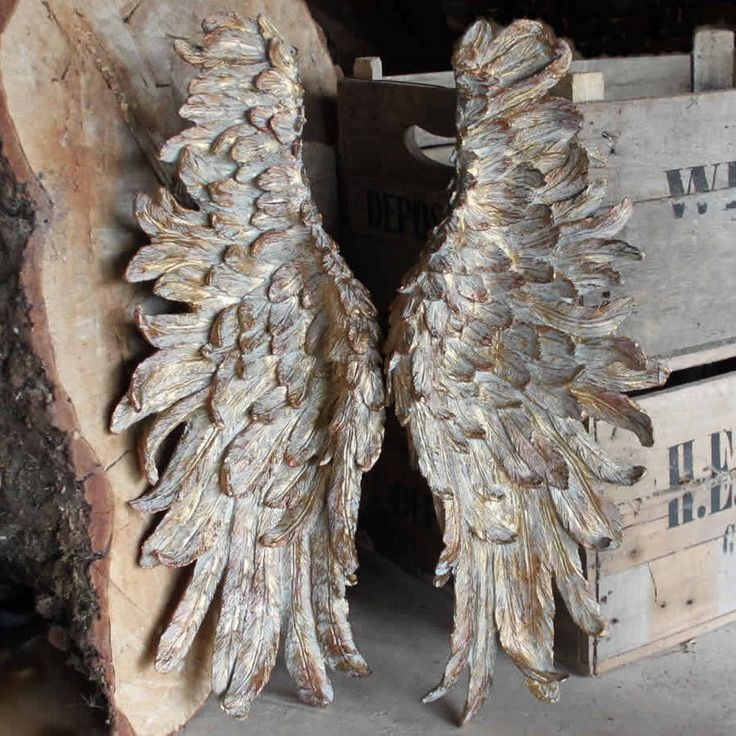 Remarkably detailed large 'Angel Wings' gold in colour.These gorgeous and impressive wings will make a welcome feature or addition to most rooms. Over a fireplace, in a conservatory or a child's bedroom. The rear of the wings are adapted to make fitting easy. Height 63cm (each wing). Due to the weight and size we only ship to the UK. Limited availability.resin.H 63cm