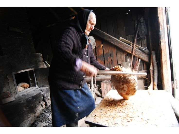 Holbav Village, Romania. photo by Marius Grozea old woman making home bread