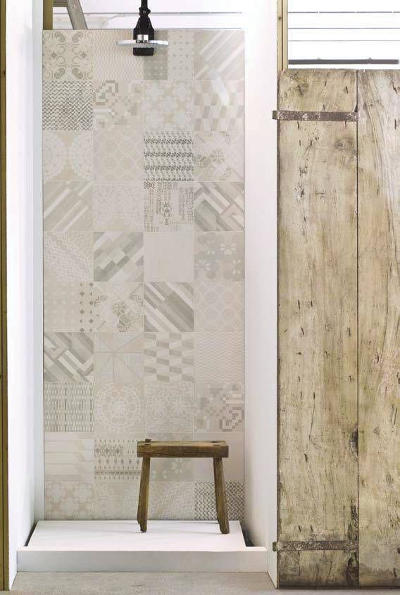 Gorgeous patchwork tiled wall in shower - Nivault.com barefootstyling.com