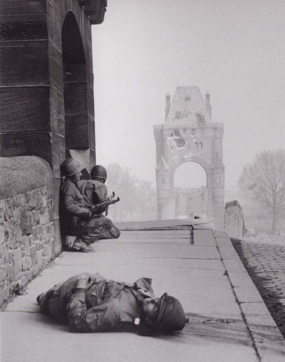 American soldiers on the Nibelungen bridge in the city of Worms, In the foreground the body of a US soldier killed by a sniper ,The position of the sniper is located on the other Bank of the Rhine. Description from pinterest.com. I searched for this on bing.com/images: