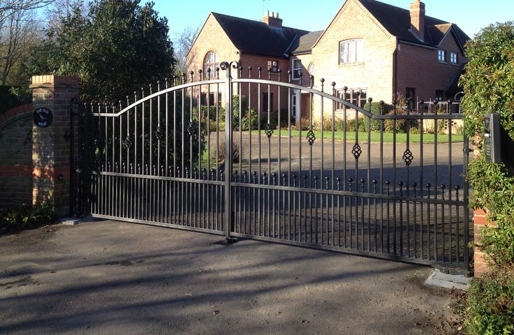 Up-arch wrought iron electric gates