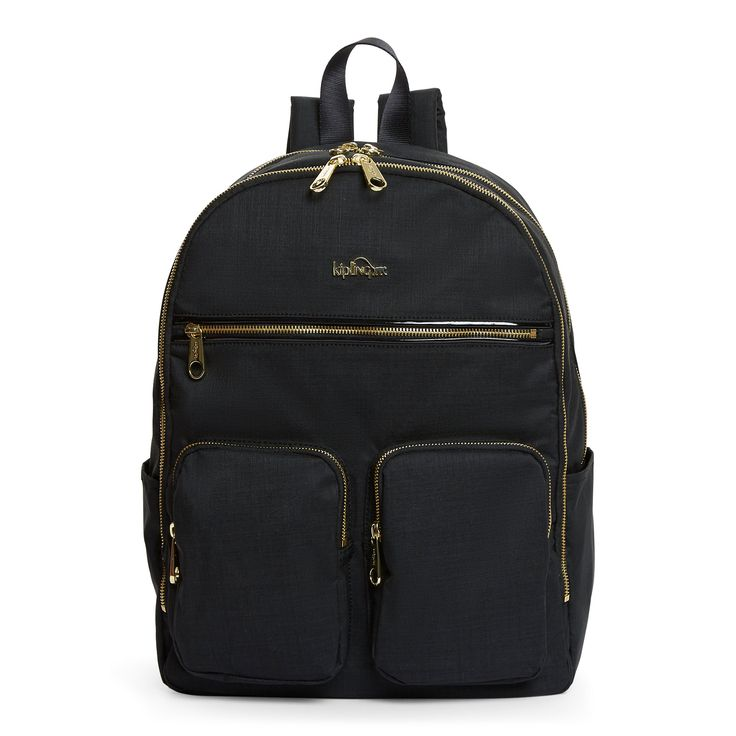 "Work it! Whether it's a weekday or a getaway, you'll love the dash of flash on the patent trim and gold zips of this backpack. Did we mention the protective laptop compartment and the exterior sleeve that slides right over your luggage handle? Just another couple of reasons to love it. <br><br>Dimensions: 13""L x 16.75"" H x 7""D <br>Weight 1.63 lbs. <br>Volume: 20L"