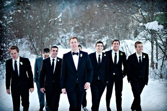Groom in a bow tie and groomsmen in a tie.