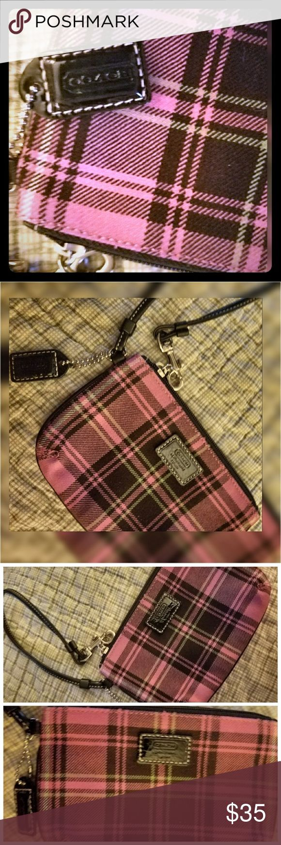 Authentic Coach Pink & Black Plaid Wristlet Just reduced from $40 to  $35 to cover most of the shipping. =)  Coach Pink & Black Plaid Wristlet  Like new!! Authentic! Purple, Black, Fushia (Pink) Checkered Has wrist strap and original Coach  hangtag  in black.  No wear! As you can see from the pictures.   Zipper works great! Originally $150 Great for your cash, cards, credit cards, ID, coins, and a lipstick or compact.  Smoke free.  **Free VS lanyard....my choice...with purchase. Coach Bags…