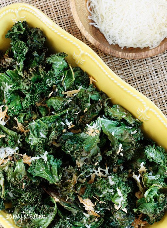 Baked Parmesan Kale Chips  1 bunch kale (12 oz after removed from stems)  1 tsp olive oil (spray)  a sprinkle of sea salt or kosher  1/2 cup shredded Parmesan cheese