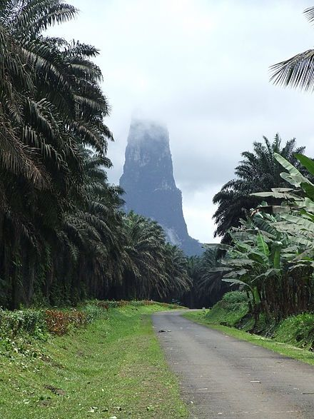 Beloved Continent --- São Tomé and Príncipe Portuguese  is a Portuguese-speaking island nation in the Gulf of Guinea, off the western equatorial coast of Central Africa. It consists of two archipelagos around the two main islands: São Tomé and Príncipe, located about 140 kilometres (87 mi) apart and about 250 and 225 kilometres (155 and 140 mi), respectively, off the northwestern coast of Gabon.  /Pico Cao Grande;  (Great Dog Peak) is a landmark volcanic plug peak, located at in southern…