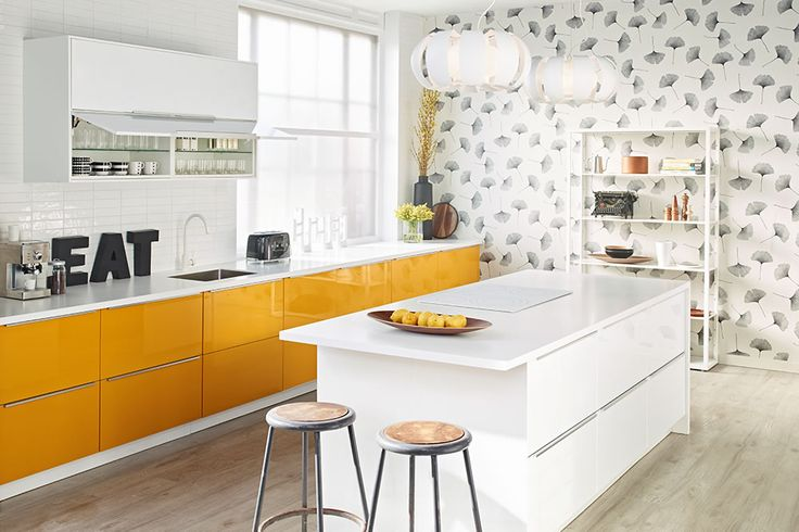 Fresh kitchen design - sleek white, bold yellow cabinet fronts, modern botanical wallpaper. IKEA
