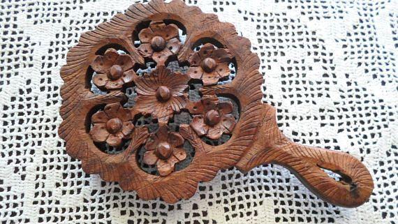 A vintage decorative  hand carved trivet  1970's.