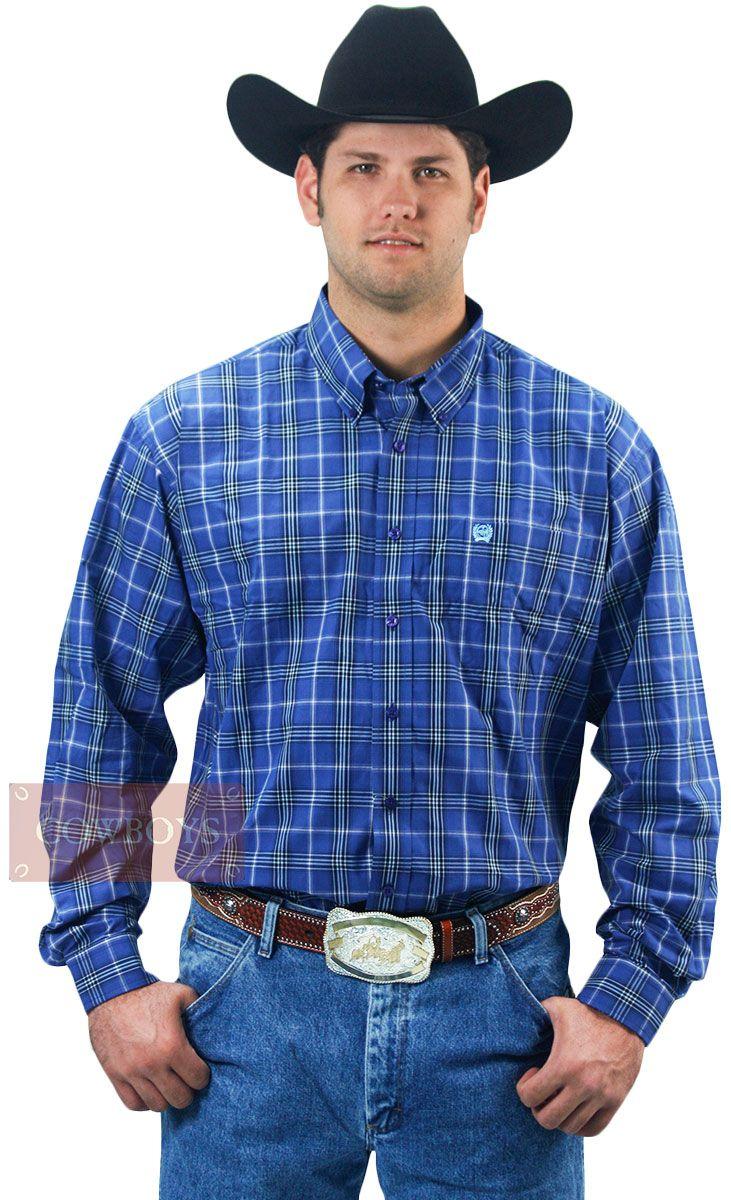 camisa Manga Longa Azul Xadrez Cinch   camisa masculina manga longa xadrez de fundo azul. Tecido muito leve 100% Algodão. Muito indicado para amantes do estilo country e para você que não abre mão de estar vestido com um tecido de alta qualidade e durabilidade. A marca Cinch é muito bem conceituada entre os cowboys de bom gosto e as camisas possuem cortes especiais, formas muito modernas e peças exclusivas.