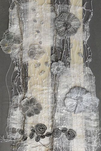 Textile art on vintage fragment by Kirstine Higgins.