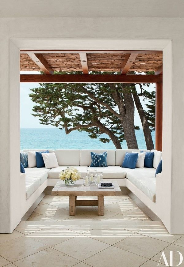 A classic Orange County vista—the Pacific through a gnarled Monterey cypress—seen from the private study's terrace, on the third level   archdigest.com