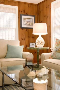Updated knotty pine room with white furniture, window treatments and white trim