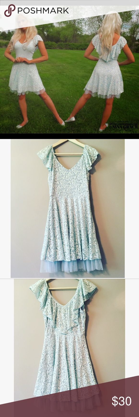 Cinderella Blue Lace Dress Worn once, this pale blue lace dress hits slightly above the knee. Has soft tulle underneath! Size medium. This was a limited edition collection from Kohls with Disney for the new Cinderella movie.  🌸Size: Medium with stretch 🌸Condition: Like New Disney Dresses Midi