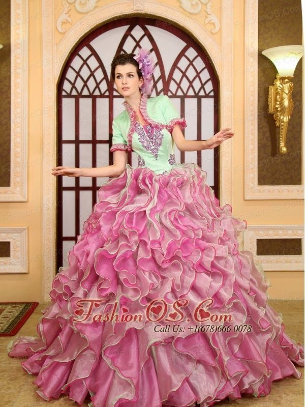 2013 Ruffles Appliques For Green and Rose Pink Quinceanera Dress With Jacket Brush Train http://www.fashionos.com You will be a real surprise in this elegant dress for all eyes!The delicate applique has been placed thoughtfully on the structured bodice. The floor-length skirt is a long and winding series of ruffles that begins at the waist and camouflages disguising a bottom-heavy figure in luxurious multi-color orangza all the way to the floor. The lace up show a beautiful ending.