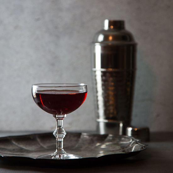 Eeyore's Requiem - a complex cocktail using Gin, Campari, Cynar, orange bitters, and Fernet Branca.