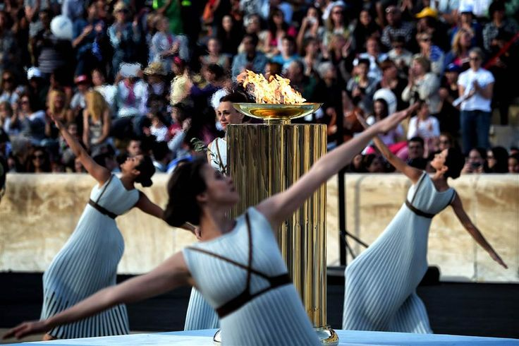 Priestesses dance around the Olympic flame burning in a cauldron, during the handover ceremony at the Panathinean stadium in Athens, on April 27. Today Greece handed over to Brazilian officials the Olympic flame of the Rio Games as the 100-day countdown to the August 5 opening ceremony.  (c) ARIS MESSINIS / AFP - Getty Images