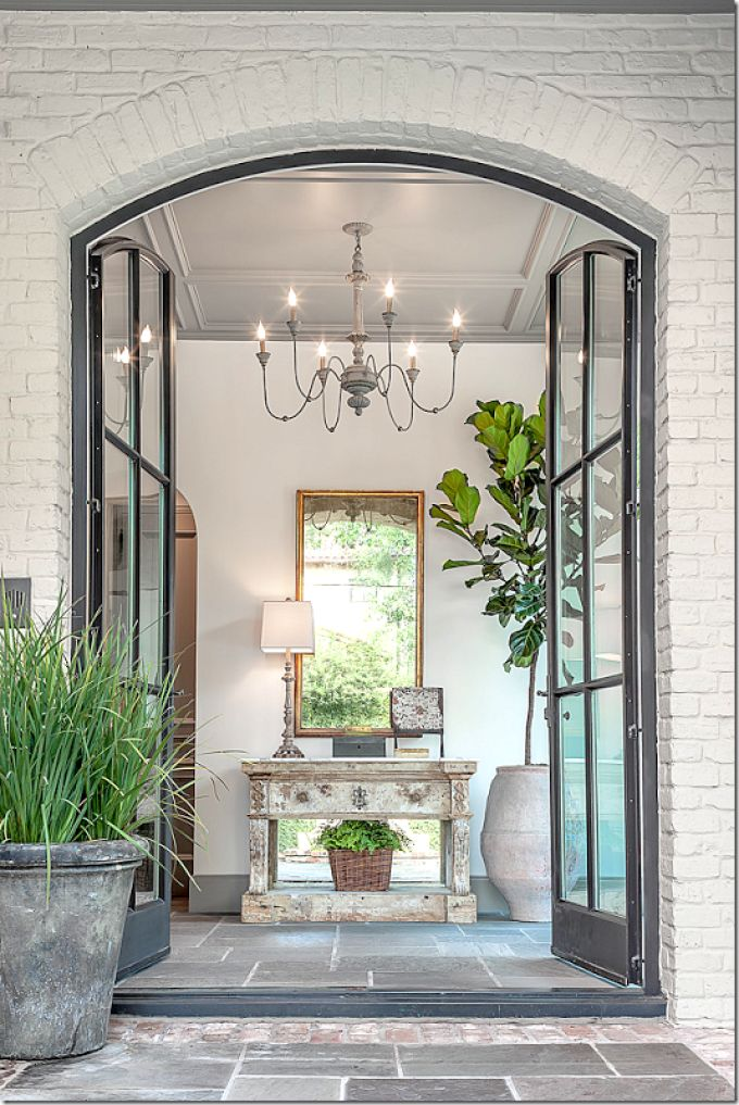 love the doors, the symmetry, the chandelier, the neutral tones......