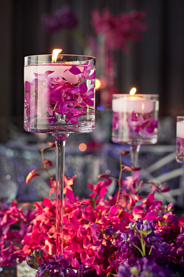 purple orchid themed floating wedding centerpiece ideas with candles and flwoers