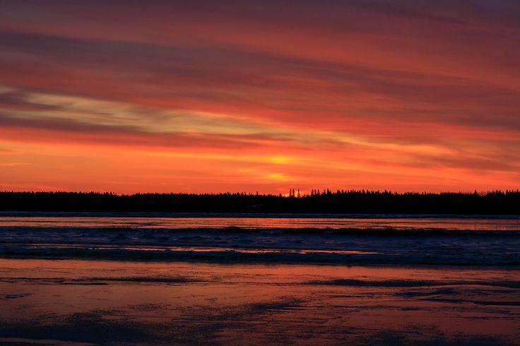 Sunrise sky and ice on the Moose River at Moosonee 2017 November 11th.