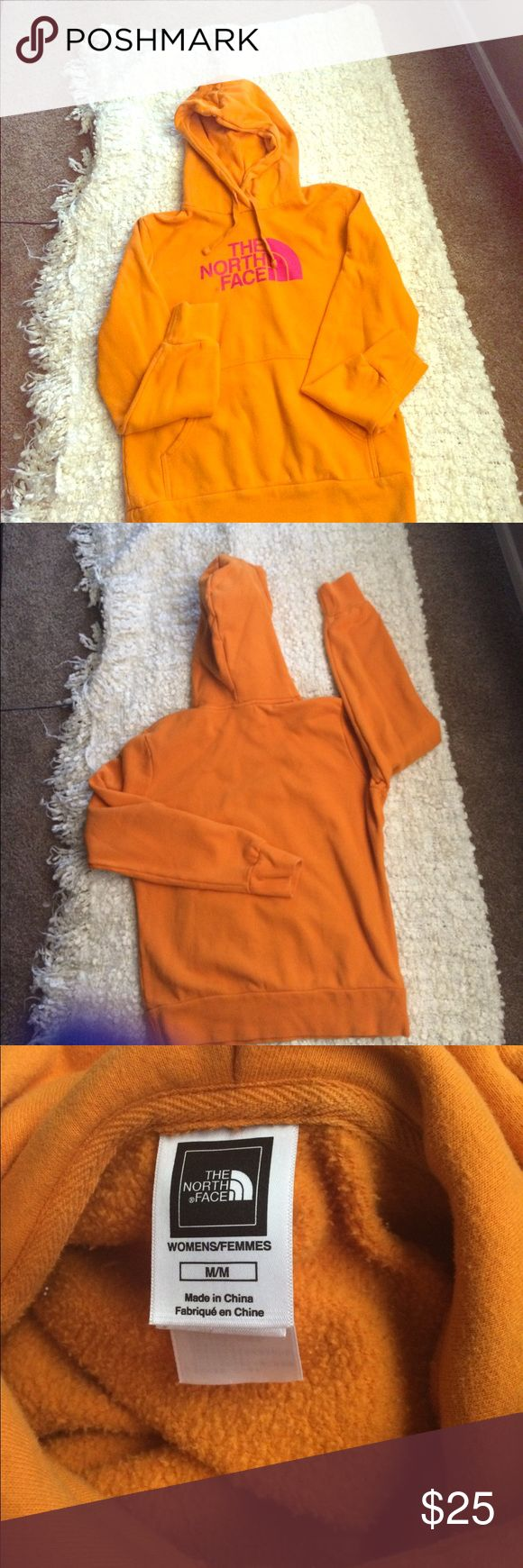 Orange with pink writing North Face hoodie Wore just a few times. In great condition. Size Medium. Orange with pink writing North Face hoodie North Face Tops Sweatshirts & Hoodies