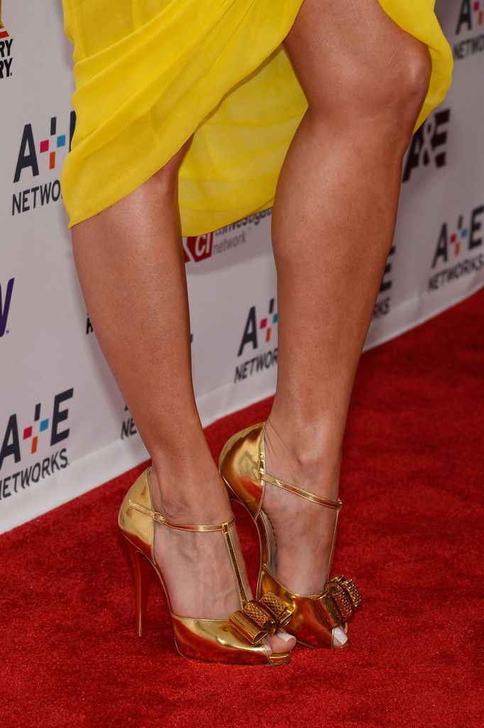 Roselyn Sanchez Evening Pumps - Roselyn Sanchez brought out the hardware on the red carpet when she rocked this pair of metallic gold pumps that featured a bow detail on the toes.