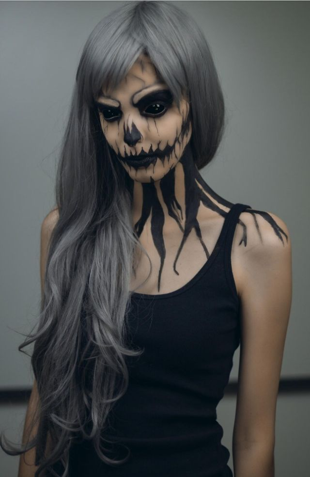 Wow, this is really cool, love here hair too. Day of the Dead Make-Up