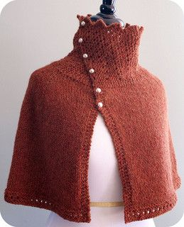 A cozy buttoned wrap (cape), knit in a light but lofty yarn makes the most of simple stitches and shaping. The garter lace collar is thick and soft, while the stockinette body is drapey and light.
