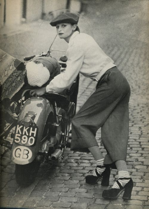 Vogue UK, 1972 | fashion | editorial | posing | motorbike | mod | cobble stone | tweed/Gaucho pants & Platform shoes