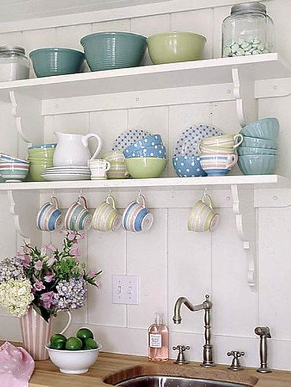 Open shelves aren't practical with pet hair, but I like the mismatched dinnerware. Maybe in a hutch with glass?