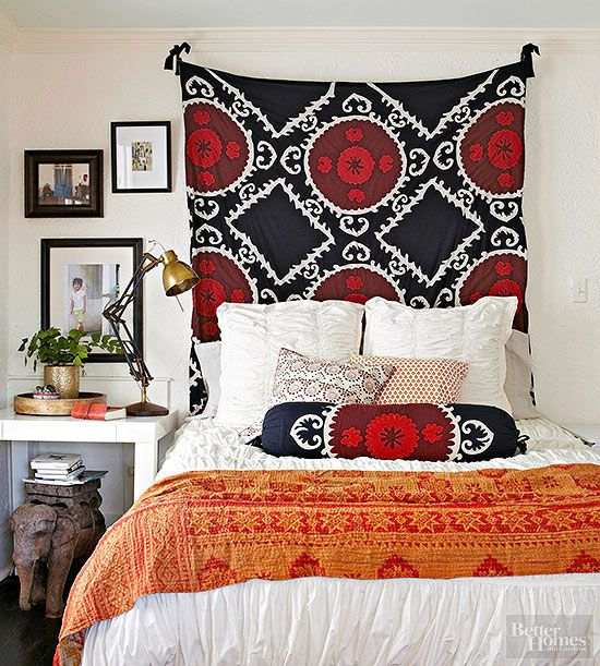 Showcase a stunning swatch of fabric by hanging it on the wall of your bedroom. When centered behind a bed, it makes a stylish substitute for a headboard. The key is hanging it high, so as much as the large-print pattern is displayed as possible.