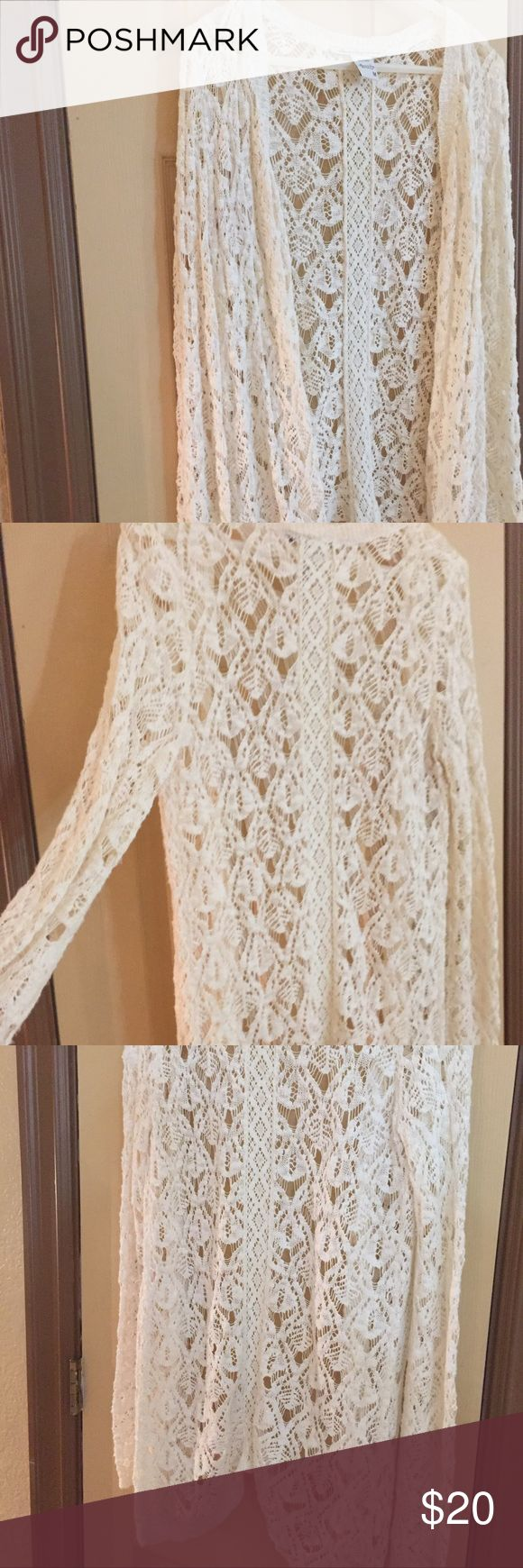 American Rag Med cream cardigan never worn American Rag crochet type cardigan size medium the color is cream would go with anything and never has been worn American Rag Sweaters Cardigans