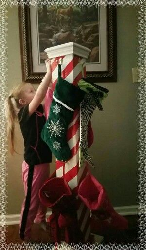 My chosen granddaughter, Gabby, places her stocking on the North Pole Stocking her uncle built. People who have no fireplace or mantle have a nice place to hang there stockings. I think it is a great idea!
