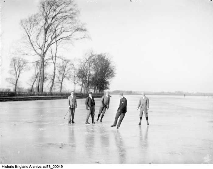 CC73/00049 Local men playing a simple form of ice hockey on the frozen Medley Port Meadow, Oxford, Oxfordshire.  Date 1860 - 1922 Photographer: Henry W Taunt
