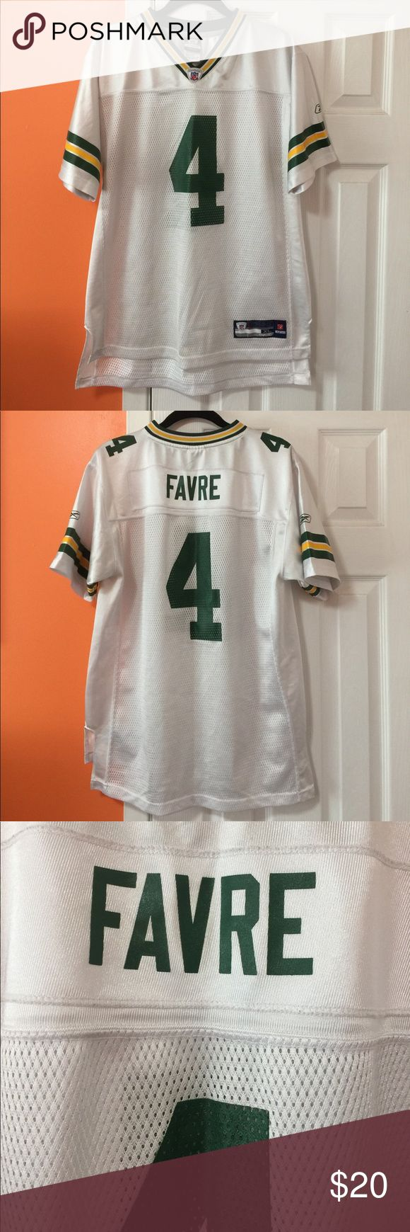 Brett Favre Jersey Favre Jersey. A collector for the true fan. Authentic  RBK... Picture shows a little discolored on front white..XL Boys 18-20. Would fit A Girls small 👕🏈🏈 NFL Shirts & Tops