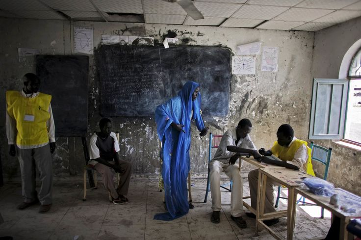 A southern Sudanese woman in the town of Melut registers to vote in the independence referendum - by Pete Muller (1982), USA
