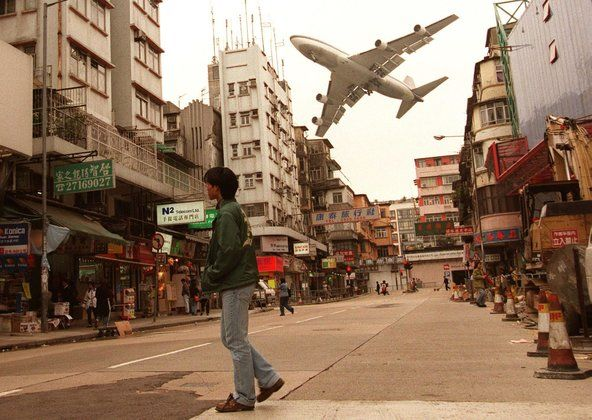 Planes landing at the old Kai Tak airport used to have to swerve between Hong Kong's densely packed residential buildings. Description from slinkingtowardretirement.com. I searched for this on bing.com/images
