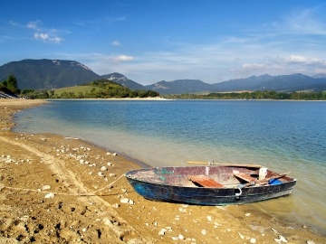 Small rowing boat by the Liptovska Mara lake, Slovakia.