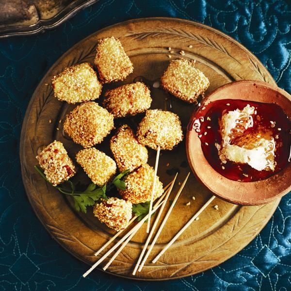 Discover how sweet honey is the perfect accompaniment to warm and crisp Sesame haloumi bites. Find more recipes from around the globe at Chatelaine.com.