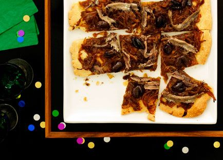Australian Gourmet Traveller recipe for caramelised onion, anchovy and olive tart.
