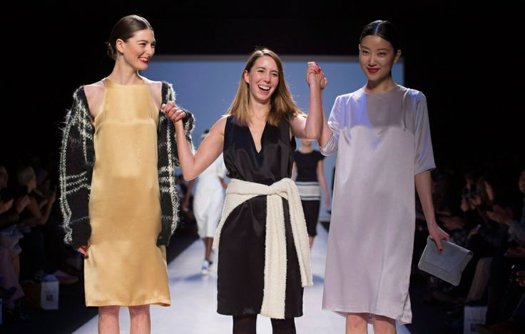 "Designer Malorie Urbanovitch, centre, flanked by models salutes the crowd in the ""Mercedes-Benz Start Up National Final"" show, during Toront..."