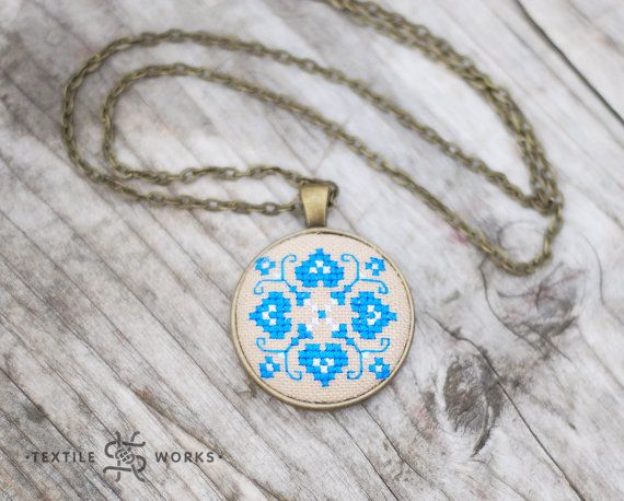 This cute pendant is permeated with the real spirit of generations. It's a hand embroidered ethno symbol on vintage homespun rustic hemp fabric, which was made by my great-grandmother during the 1950s-1960s.  This ethno symbol Blue Quatrefoil will bring good luck and complements the unique image of its owner. It is a great accessory for an everyday wear, and you can wear it on a festive occasion too.  The pendant is stuffed with holofiber filling.  Embroidered part of the pendant is 3.1 cm…
