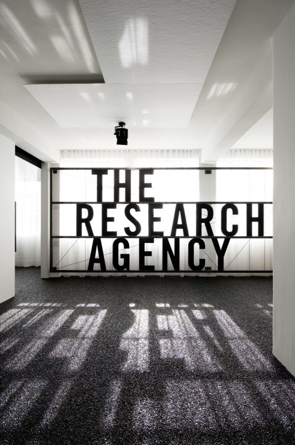 Enter The Research Agency, a boutique market research company in Auckland, New Zealand. This 200sqm fit out designed by Jose Gutierrez is a little gem. Situated in a 1920s building, the space is blessed with a fantastic bone structure which has been cleverly overlaid with a bold, sleek and beautifully detailed interior. Some of the things I really, really like – the entry billboard signage constructed out of raw steel and the seamless and shimmering black gloss gravel floor.