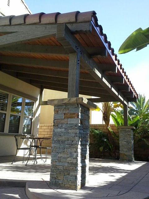 Backyard Patio Cover Design With Stone Pillars Tile Roof
