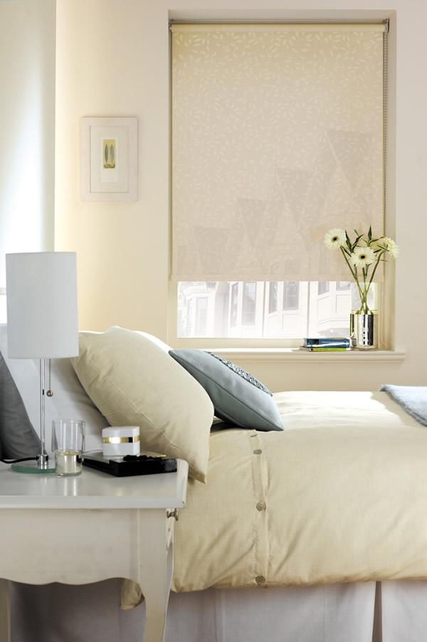 Cream leaves patterned roller blind in a cream bedroom