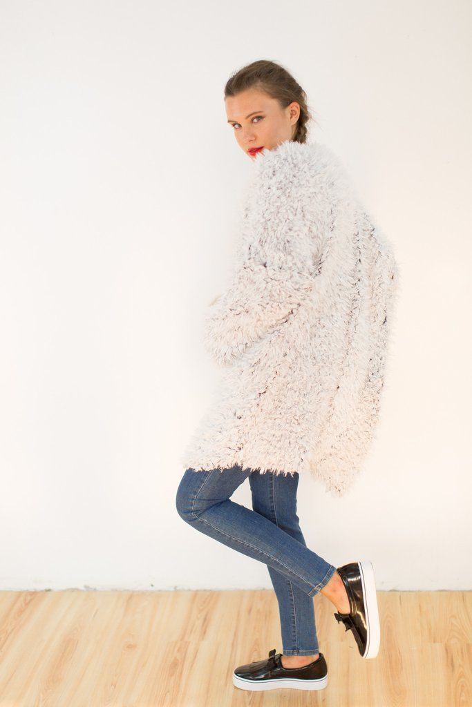 Jacket Yeti. Cosy, fluffy jacket in white with black lining. Exude glamour in this eye-catching faux fur jacket while keeping warm. Wear with a plain tee and jeans for day-to-night styling.